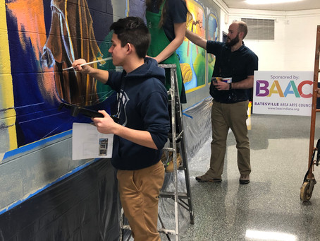 Muralist John McCoy and students complete mural at Oldenburg Academy