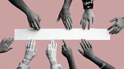 diverse-hands-touching-white-paper-mockup-pink-wallpaperrediz.jpg