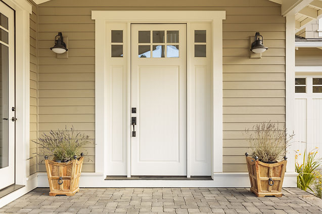 White front door with small square decor