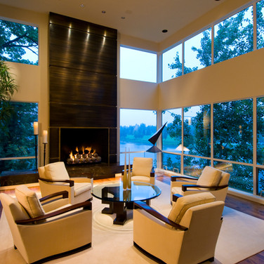 A contemporary living room with a view overlooking the river.