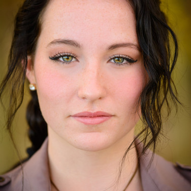 young-woman-headshot-portrait-looks-like