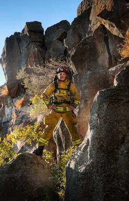 fire-rescue-man-standing-in-rocks.jpg