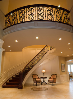 Spiral staircase in luxury home in Forest Heights, Portland, Oregon.  By architecture photographer Timothy Park