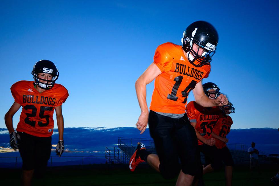 high-school-football-player-runs-to-position.jpg