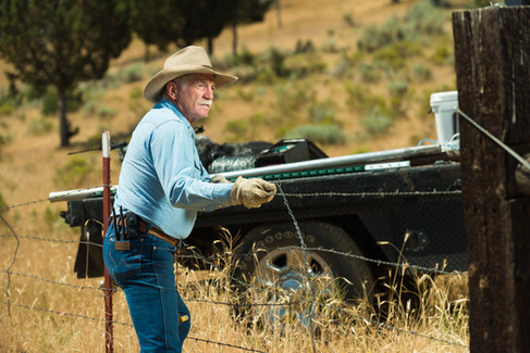 ranch-man-sets-barbed-wire-fence.jpg