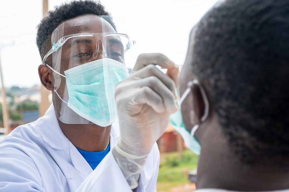 an african lab scientist taking nasal sample from a man.jpg