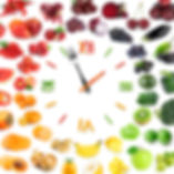 Food clock with collection of fruits and