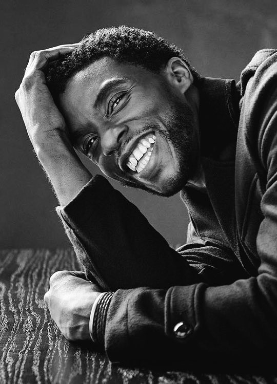 Picture of Chadwick Boseman smiling in black and white