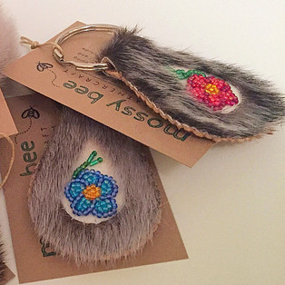beaded seal fur keychains with smoked moosehide leather backing