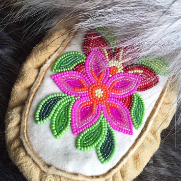 women's beaded smoked moosehide moccasins with wolf fur trim