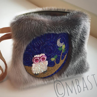 beaded sealskin clutch bag with smoked moosehide leather strap