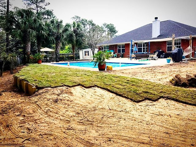 Sod going in, on a Thursday! #theturftailors #landscaping #landscaping #retainingwall #pavers #zoysi