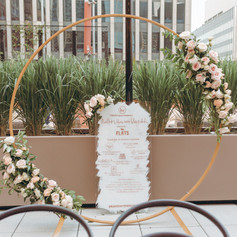 Rose Gold and White Signage with Logos