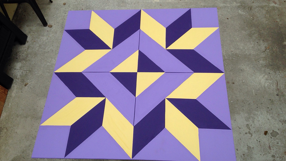 Pacific Textile Arts has installed their block on Alger St.