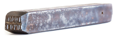 A tool-steel stamp used to brand polycarbonate bibs on early, hand-made Downunder Boomerang fishing lures