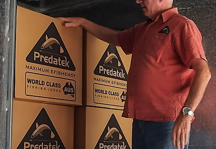 Predatek director, Frank, load another export shipment of fishing lures
