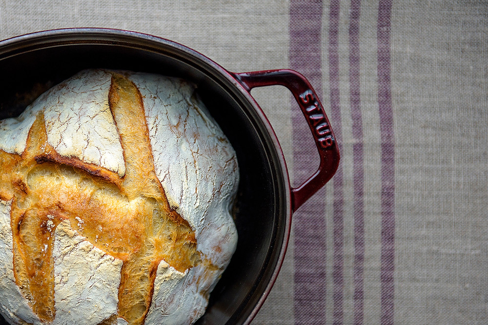 Bake your bread in a cast iron dutch oven.
