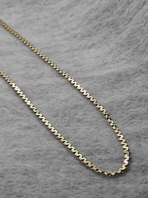Yellow gold S link chain