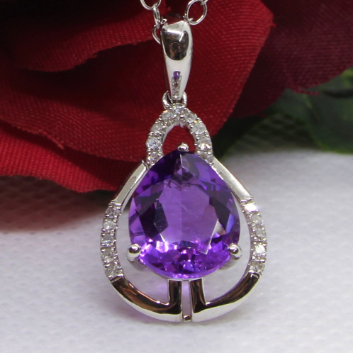 * 9ct gold Amethyst and Diamond pendant and chain