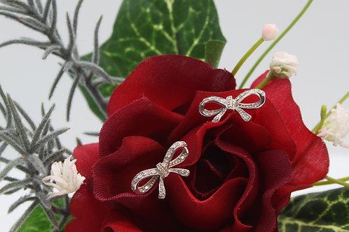 * 9ct gold Diamond bow earrings