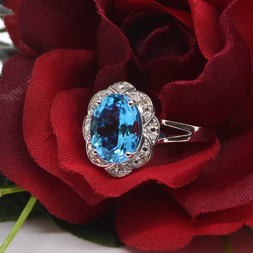 * 9ct gold Blue Topaz and Diamond ring