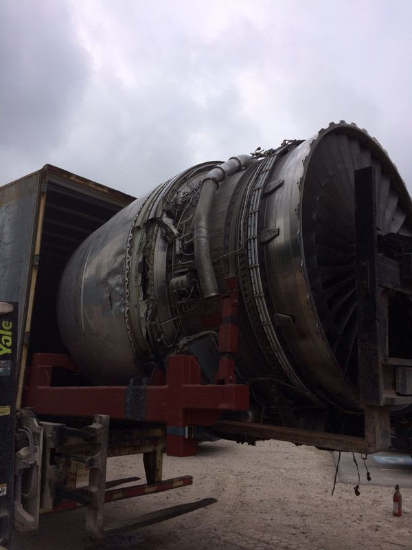Scrap RB211 jet engine being loaded for transport to the U.S. for recycling.