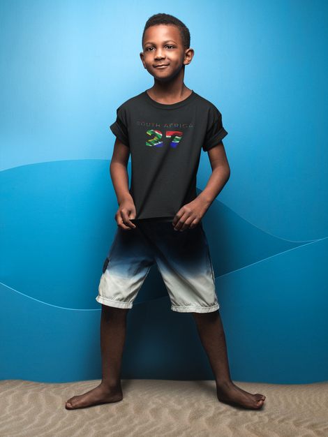 kid-showing-his-t-shirt-mockup-against-a