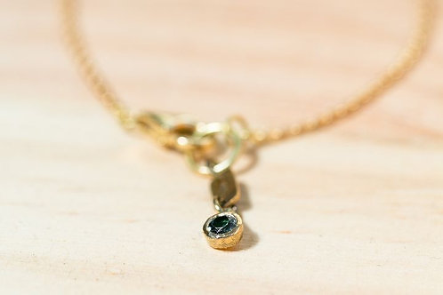 Bracelet en or jaune 750/00 et tourmaline verte
