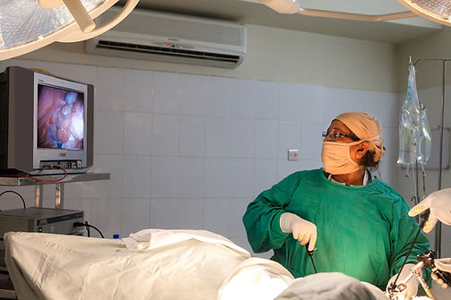 Prof Dr Firoza Begum performing surgery