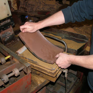 The pad of clay is extruded under pressure to create the required compaction and give the tile its inherent strength.
