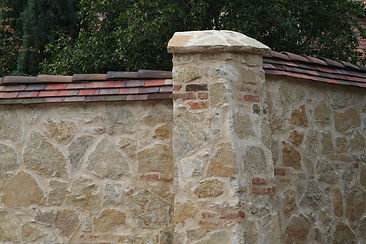 Clay Roof Tiles used on top of a garden wall