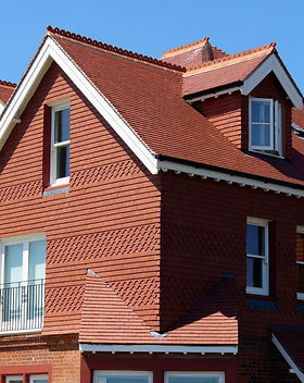 Using roof tiles on a roof or vertically on walls