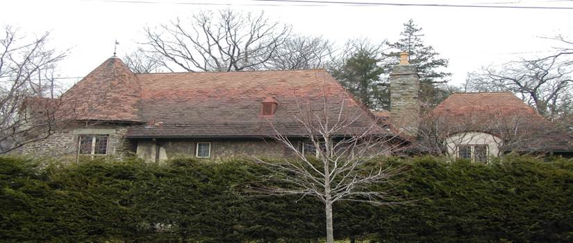 Home with blended shingle tile