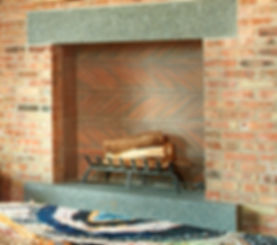 Fireplace designed by Liederbach and Graham Architects using clay roof tiles