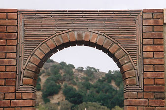 Clay Roof Tiles used in a garden wall over an arch
