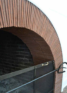 Fireplace arch using clay tiles