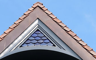 Glazed Beavertail Roof Tiles used as exterior wall feature