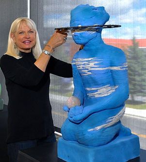 Ceramic artist Paula Rice with Neptune, the Planet Series, photo by Betsey Bruner