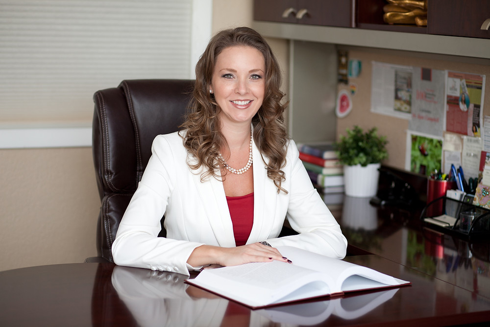 Dr Kate Campbell Sitting on her desk in Fort Lauderdale Office | Family Therapist | Maternal Counseling | New Mom Counseling