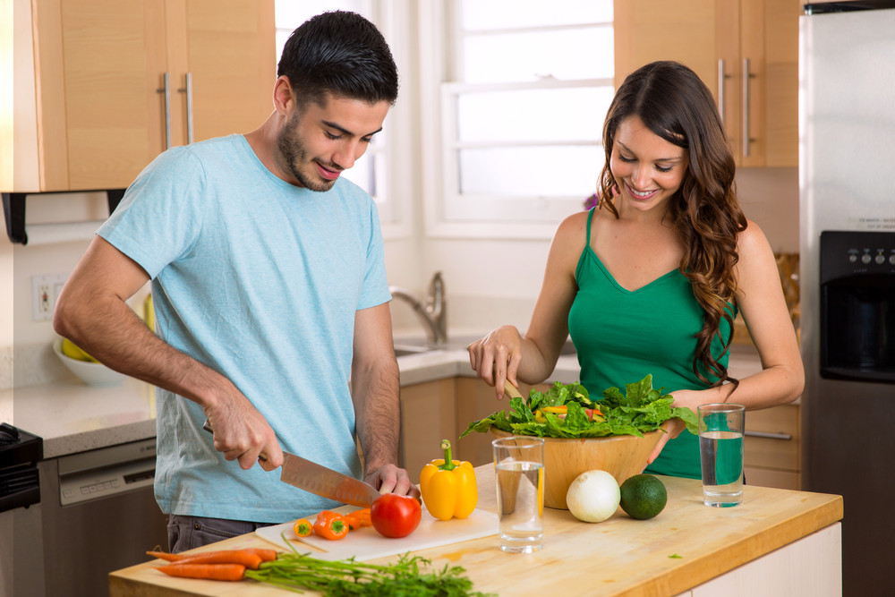 Couple is enjoying healthy gut friendly dinner making together. Gut Feeling