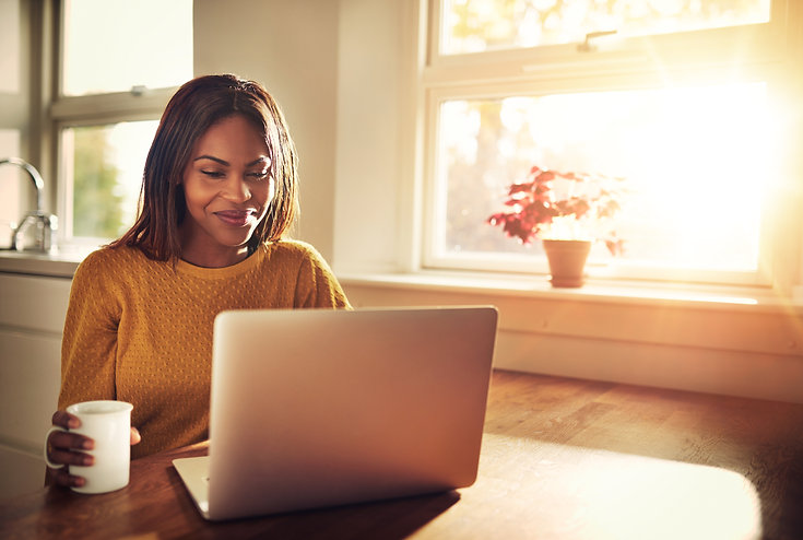 Woman on computer smiling | online therapy in Florida | online therapist | online therapy in coral springs, fl | online therapy fl | online therapy for adults | 33301 | 33316 | 33308 | 33306