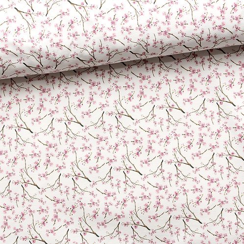 0.5m Baumwolljersey Blütentraum cremeweiß