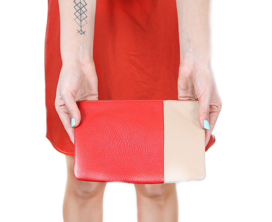 Tattooed woman holding purse