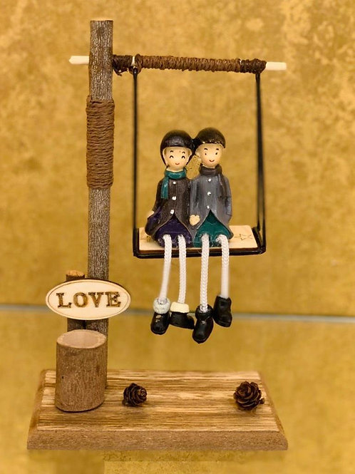 Lovely Couple on the Swing Giftable Showpiece