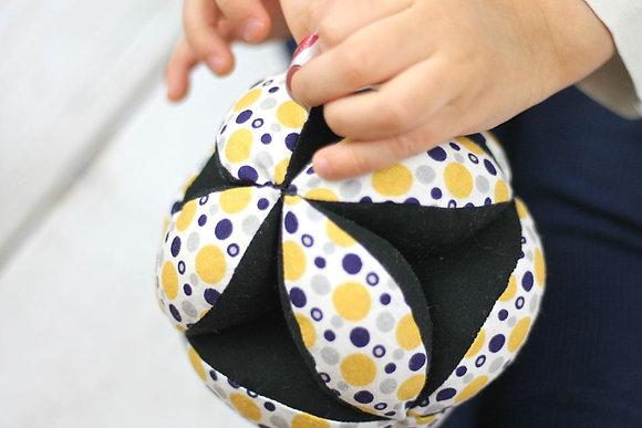 Balle de préhension Montessori Jaune bleu noir
