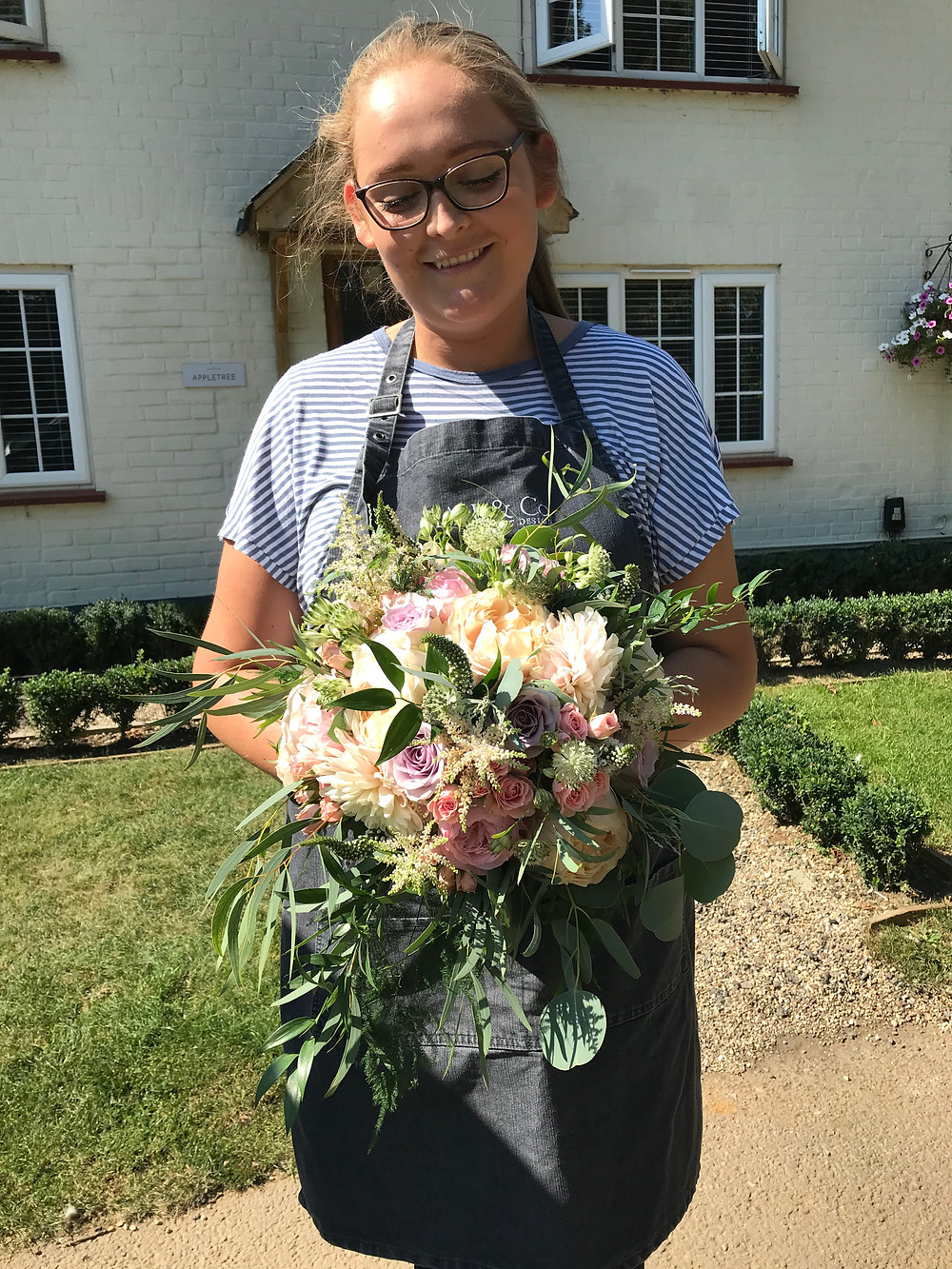 Kerry delivering a bridal bouquet on the morning of the wedding