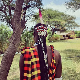 Maasai warrior at the Maasai Giraffe Eco lodge. It is located in Tanzania, near Arusha and Loliondo. We are on the road to the Serengeti, Ngorongoro and Tarangire parks. We stand for ecotourism, responsible tourism and nature conservation. We offer cultural stays and discover the Maasai community in an unusual place. Many activities are proposed: treks, tailor-made safaris, volcano climbing, immersion in a Maasai family, visit of a Maasai village, Maasai barbecue. Close to pink flamingos, zebras, giraffes and many birds.