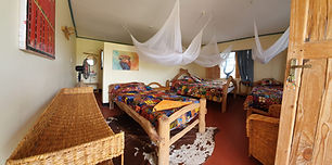 Twin room at Maasai Giraffe Eco Lodge located in Northern Tanzania, facing the Ol Doinyo Lengai volcano, near Lake Natron. We offer an eco camp with camping and self-contained room. We stand for fair and sustainable tourism. Close to the Serengeti, Ngorongoro and Tarangire parks. Many activities are available: safaris, treks, volcano climbing, cultural encounters, immersion in a Maasai family, visit of a Maasai village, Maasai barbecue. Close to pink flamingos, zebras, giraffes.