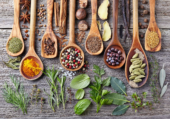 Herbs and spices on a wooden board.jpg