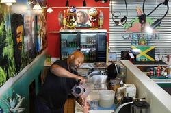 Owner, Rod Osavio making a smoothie
